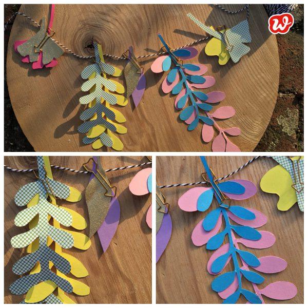 Collage aus Herbstpapierblättern als Girlande