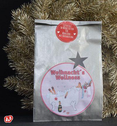 Wunderle Weihnachtswellness Wundertüte vor Glitzerkranz